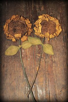 pinner says..Sunflowers made using a vintage chenille bedspread. Stems are sticks from the backyard. Leaves are just yellow painted muslin.