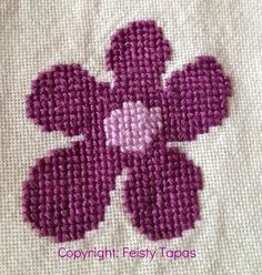 Purple cross stitch flower with free pattern