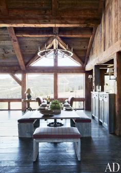 A trestle table and benches anchor the dining space in a Big Sky, Montana, lodge.