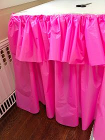 DIY Ruffle Table Cloth ... Use a plastic dollar store table cloth and fold the end over for ruffles.