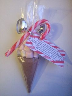 Snowman soup cones.  Contains one serving of hot chocolate mix, marshmallows, and a candy cane to stir!