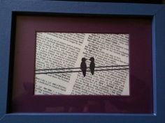 """I'm not really the best artist, but I saw this somewhere else and decided that I could do this.  I bought an inexpensive frame and painted it.  I bought a dictionary at a thrift store for a few bucks.  I used the page that has the word """"love"""" on it.  I then went online and found an image of a love birds and copied the image using pencil first and then tracing over in black sharpie.  All-in-all this cost under ten dollars and made a great present for my boyfriend."""