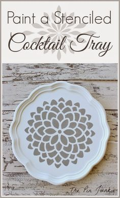 Paint A Stenciled Cocktail Tray -- great DIY directions. That tray was a not-so-attractive wood brown. Love how fresh it looks now!