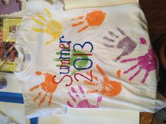 Fun summer craft I did today with the kids I nanny!!! Put my hands and their hands on the shirt!
