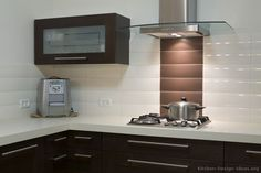 #Kitchen Idea of the Day: Modern Dark Wood Kitchen with a tile backsplash.