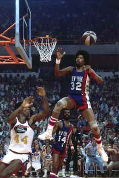 Julius Erving flies to catch and dunk an alley-oop pass against the New York Knicks during a 1975 game in New York