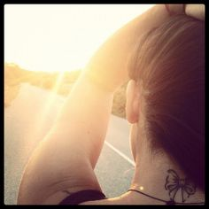 Back of the neck bow tattoo