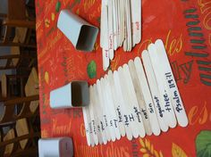 Bible Drill verse on craft sticks stored in separate containers.  By Jenni Carter