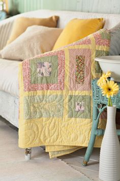 Simple squares and rectangles combine with sashing to create a quick-to-finish springtime maze.