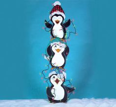 Christmas Tangled Trio of Penguins with Lights Wood Yard Art/Lawn Decoration. 50.00, via Etsy.