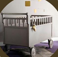 A vintage cradle on wheels.