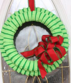 Get ready for the Christmas season with this homemade holiday craft. This Ruffle Fabric Two Tone Wreath is a fun way to make your own wreath and creative decoration that will surely make an impression.
