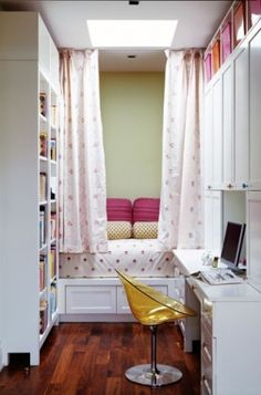 Great girl's teen's bedroom space with bookshelves and desk     Love the little sleeping nook and yellow lucite desk chair! Soft green paint wall color, bookshelves, wood floors, yellow acrylic chair, built-in bed, white and red polka dot bedding and drapes, white desk and cabinets, skylight, pink and polka dot lumbar pillows and pink and orange baskets.