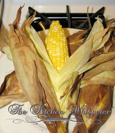 Baked corn on the cob...  Preheat oven to 350 with rack in the middle.   Place ears of corn directly on the hot rack.   Bake for 30 minutes.   Carefully remove from the oven and enjoy!