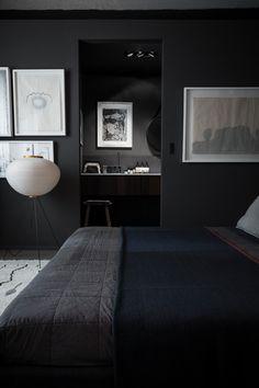 black walls + black bedding + white frames