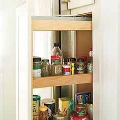 Pull-Out Pantry | A pull-out pantry component can help take advantage of an awkward slender space. | SouthernLiving.com
