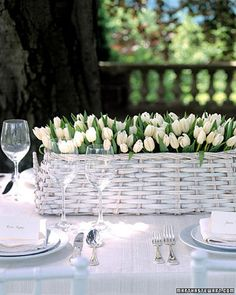 simple basket, elegant flowers. white gardens, table settings, garden decorations, flower centerpieces, wedding flowers, white weddings, tulips, easter centerpiece, wedding centerpieces