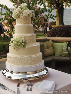 Buttercream wedding cake with simple scrolling pattern and fresh flowers by The White Flower Cake Shoppe