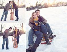 couples christmas pics. I need a sled like this!!
