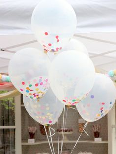Confetti-Filled Balloons. Cute for a one year old bday or even baby shower.