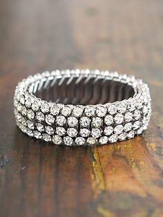 Vintage 1950s Rhinestone Embellished Stretchy Bracelet. http://www.freepeople.com/vintage-loves-waxing-poetic/vintage-1950s-rhinestone-embellished-stretchy-bracelet-26557777/