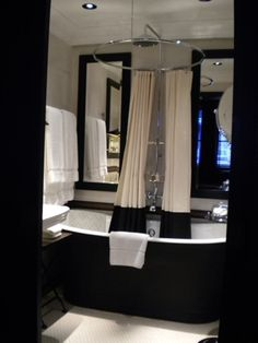 Love the black tub and the shower curtain!