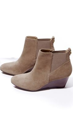 Ultra wearable suede wedge bootie with pull tabs, almond toe and elastic gore detail.