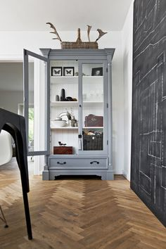 Grey cabinet with black and white accessories and chalk wall. (have the chalk wall go all the way up to the ceiling, but not all the way to the walls)