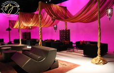 Indian wedding decor, hot pink and orange pipe and drape idea for events