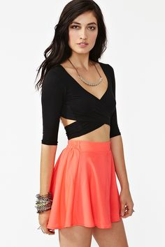 Crossed Out Crop Top | This top shows a lot if skin on the mid torso area but with the right skirt and accessories it'll look chic and classy. :)