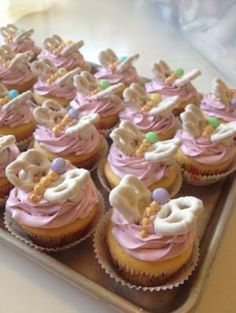 Butterfly Birthday Party: pretzel winged butterflies on cupcakes.