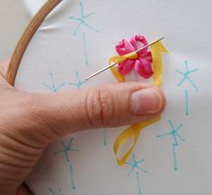 How to embroider a flower with ribbon