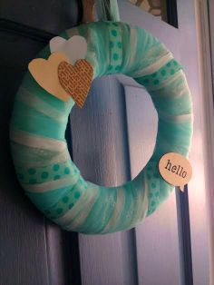 Shabby chic #babyshower wreath - love the book page heart, which ties in with the book theme!