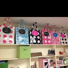 Cheap classroom storage. Gift bags on a top shelf to hold class book sets