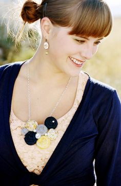 Turn heads in this one-of-a-kind, handmade necklace with classic navy, yellow, and dainty yellow floral print rosettes. Adorned with jewels and sparkle embellishments and classic pearls. #handmade #jewelery #necklace #handmadenecklace #etsy #diy #rosettes #longnecklace www.gmichaelsalon.com
