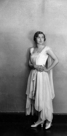 """""""Model wearing gown made of gauzy fabric with hemline of different lengths."""" #vintage #fashion #1920s #dress"""