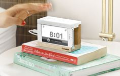 Slap to silence your iPhone alarm in the morning with Snooze, the solid wood bedside stand.