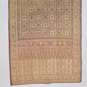 Red cotton shouldercloth kain songket with supplementary weft gold thread star and flower motifs and tumpal lanes with coloured highlights, the border with memorial text and dated 27-7-34, 210 x 80 cm, Palembang, SUMATRA