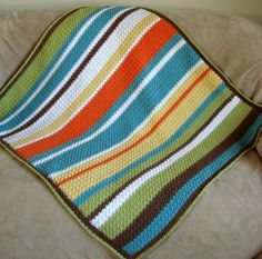 textured random striped blanket. I love the colors.