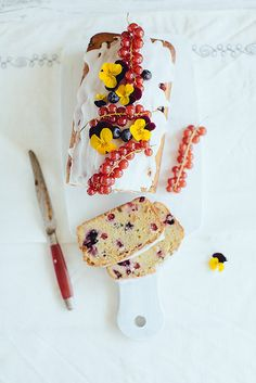 Pound cake with berries and pansy flowers