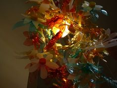recycled art flowers made from the tops of bottles