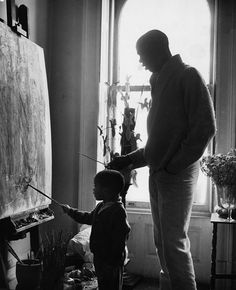 """Education begins at the home. You can't blame the school for not putting into your child what you don't put into him."" - Geoffrey Holder. The legendary dancer Carmen de Lavallade shared this beautiful photo on her Facebook page of her husband, the legendary dancer, actor, painter and director Geoffrey Holder with their son, Leo."