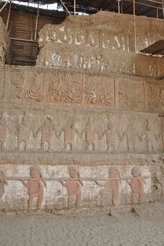 North wall of Huaco Del Luna shows slaves at the bottom, Moche warriors above and the different gods above them   Trujillo, Peru