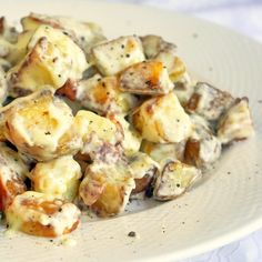 Creamy Parmesan Bacon Potatoes. These are possibly the most indulgent potatoes I have ever eaten, combining crispy hash browns with crisp cooked bacon, all tossed in a creamy parmesan sauce.