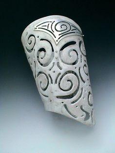 Cuff | Angela Baduel-Crispin.  Faux Bone with fine silver metal clay details.