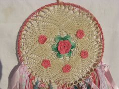 Dreamcatcher Wall Hanging - Vintage Lace pink flower - Vintage Pink Flower Doily in web with yarn hanging down, beads and crystal drop. $54.00, via Etsy.