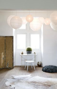 all white #interior #home #room #space #paper #lanterns #lantern #light #cowhide #rug #wood #wooden #floor #floors #floorboard #white #decor #style