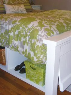 I combo of Ana White's Farmhouse Bed and captain bed with an extra twist of a hinged foot board for extra storage. The best of both world!