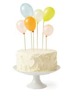 Cute, easy cake idea: glue small balloons to skewers instead of candles.