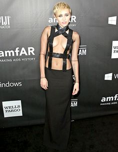 Miley Cyrus left little to the imagination in a sexy Tom Ford gown which exposed a lot of cleavage.